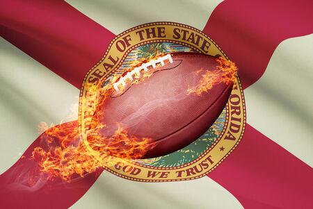 college footbal: Pelota de f�tbol americano con la bandera en serie apaisada - Florida