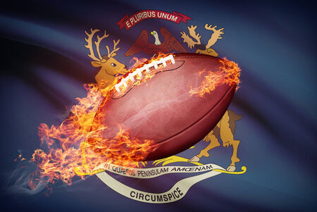footbal: American football ball with flag on backround series - Michigan Stock Photo