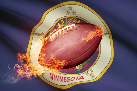 college footbal: American football ball with flag on backround series - Minnesota Stock Photo