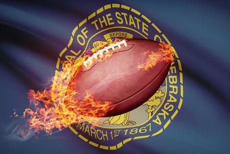 American football ball with flag on backround series - Nebraska Stock Photo