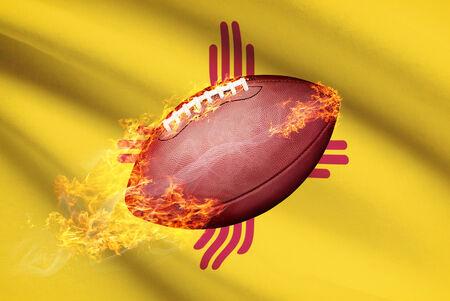 college footbal: Pelota de f�tbol americano con la bandera en serie apaisada - Nuevo Mexico Foto de archivo
