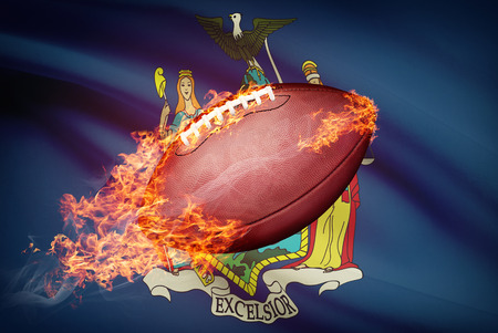 American football ball with flag on backround series - New York Stock Photo