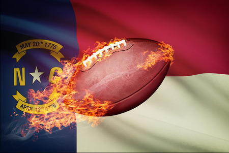 college footbal: American football ball with flag on backround series - North Carolina Stock Photo