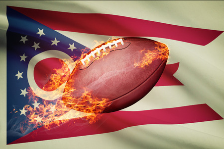 college footbal: American football ball with flag on backround series - Ohio Stock Photo