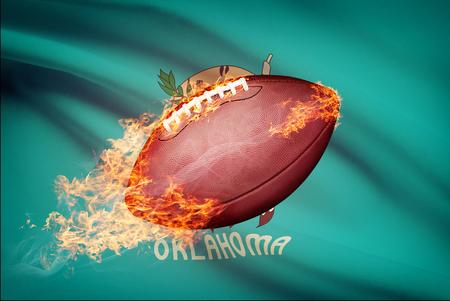 American football ball with flag on backround series - Oklahoma Stock Photo