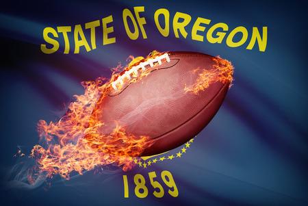 college footbal: Pelota de f�tbol americano con la bandera en serie apaisada - Oregon