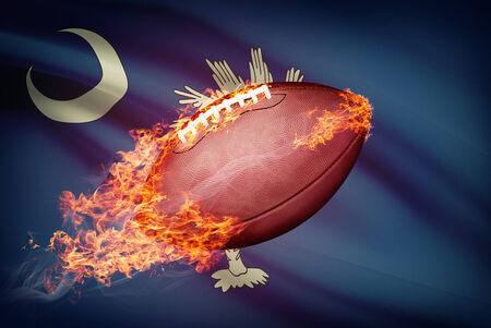 college footbal: American football ball with flag on backround series - South Carolina Stock Photo