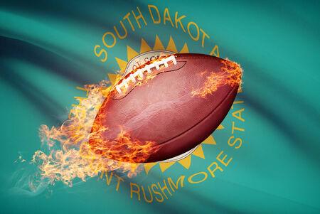 college footbal: Pelota de f�tbol americano con la bandera en serie apaisada - Dakota del Sur Foto de archivo