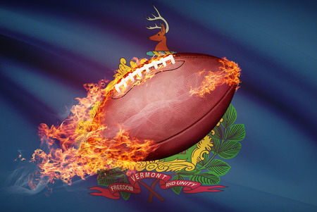 college footbal: American football ball with flag on backround series - Vermont Stock Photo