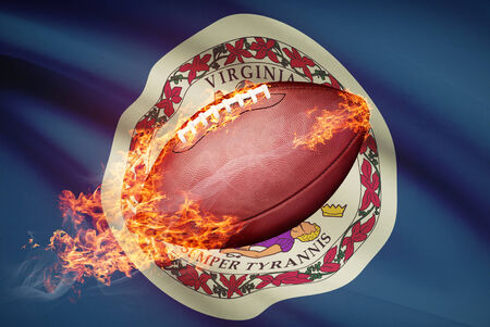 college footbal: American football ball with flag on backround series - Virginia Stock Photo