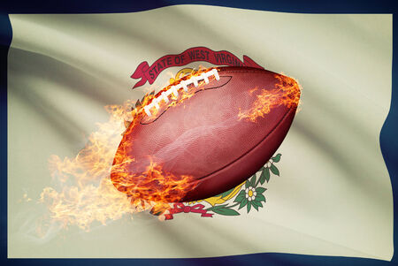 college footbal: American football ball with flag on backround series - West Virginia Stock Photo