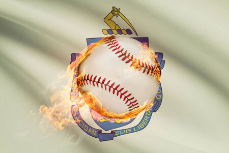 fast pitch: Baseball ball with flag on background series - Massachusetts Stock Photo
