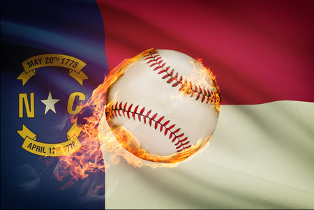 fast pitch: Baseball ball with flag on background series - North Carolina