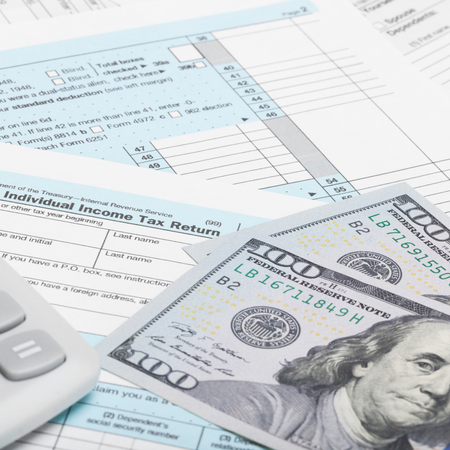 taxable income: US of America Tax Form 1040 with calculator and dollars - 1 to 1 ratio