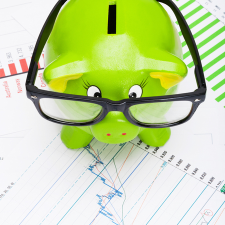 Piggy bank with stock market chart - 1 to 1 ratio photo
