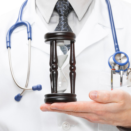 by pass surgery: Doctor with hourglass in hand - 1 to 1 ratio