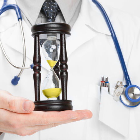 by pass surgery: Doctor holdling hourglass - 1 to 1 ratio