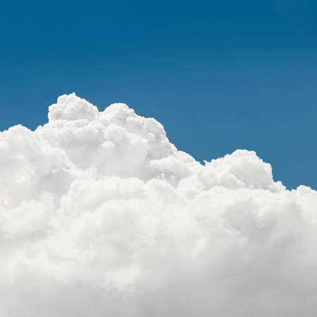 Blue sky with cumulus clouds - 1 to 1 ratio photo