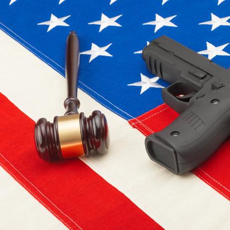 amendment: Gun and judge gavel over USA flag - studio shoot Stock Photo