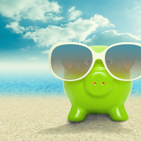 Piggy bank in sunglasses  photo