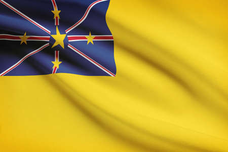 niue: Flag blowing in the wind series - Niue Stock Photo