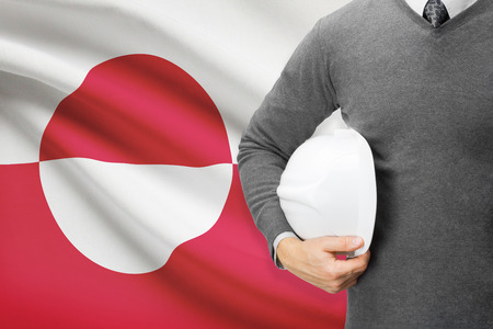 greenlandic: Engineer with flag on background - Greenland
