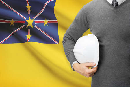 niue: Engineer with flag on background - Niue