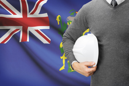 pitcairn: Engineer with flag on background - Pitcairn Group of Islands Stock Photo