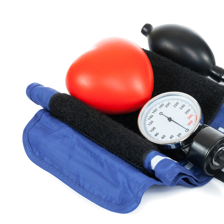 Blood pressure measuring tools with red toy heart photo