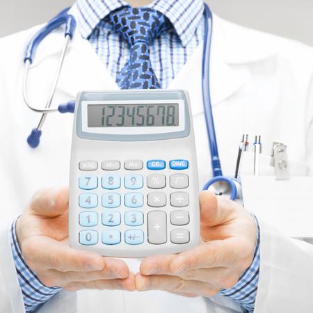 Doctor holdling calculator - studio shoot photo