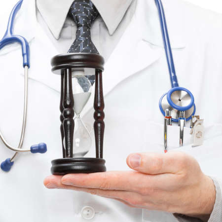 by pass surgery: Doctor holdling hourglass Stock Photo