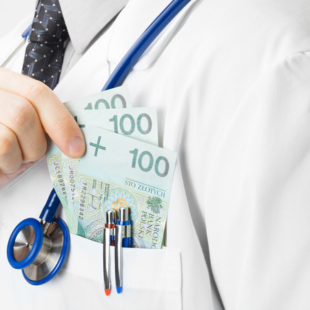 doctor putting money: Doctor putting some money into his pocket Stock Photo