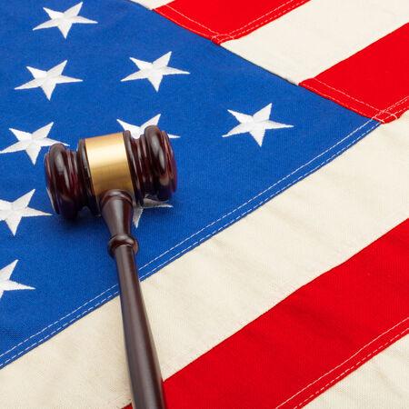 Judge gavel over USA flag - closeup shoot photo