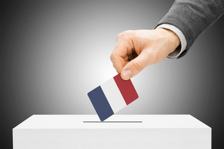 Voting concept - Male inserting flag into ballot box - France photo