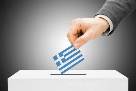 Voting concept - Male inserting flag into ballot box - Greece photo