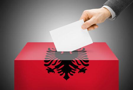 Voting concept - Ballot box painted into Albania national flag photo