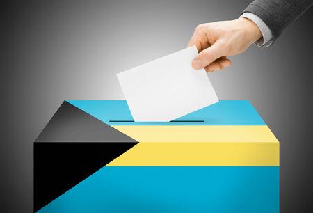 Voting concept - Ballot box painted into Bahamas national flag Stock Photo