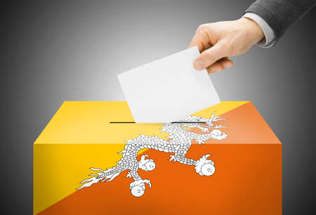 electoral system: Voting concept - Ballot box painted into Bhutan national flag colors
