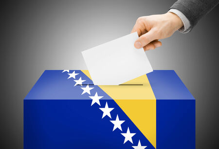 Voting concept - Ballot box painted into Bosnia and Herzegovina national flag colors photo