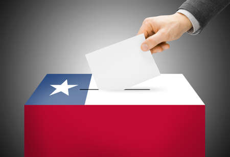 Voting concept - Ballot box painted into Chile national flag photo