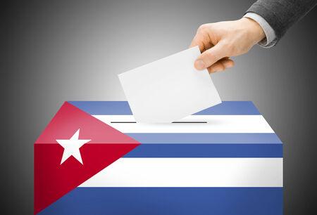 Voting concept - Ballot box painted into Cuba national flag photo