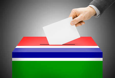 electoral system: Voting concept - Ballot box painted into national flag colors - Gambia