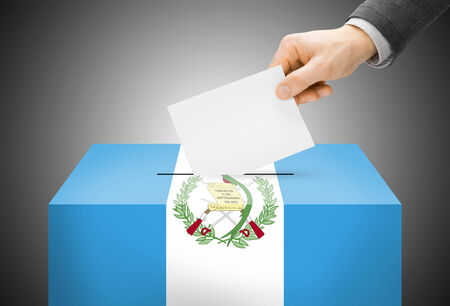 electoral system: Voting concept - Ballot box painted into Guatemala national flag Stock Photo
