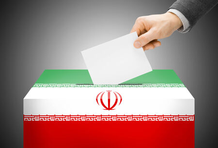 Voting concept - Ballot box painted into national flag colors - Iran photo
