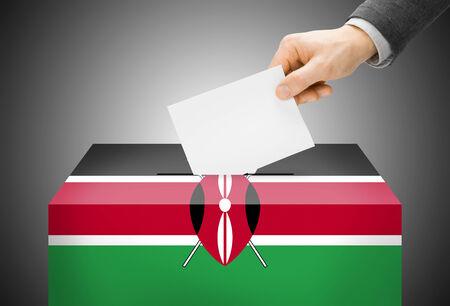 Voting concept - Ballot box painted into Kenya national flag photo