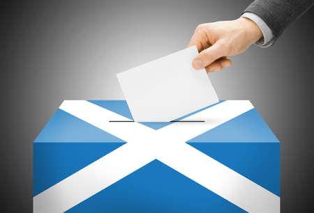 scottish parliament: Voting concept - Ballot box painted into Scotland national flag