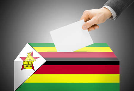 Voting concept - Ballot box painted into Zimbabwe national flag photo