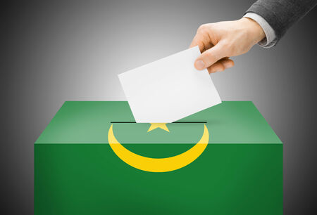 Voting concept - Ballot box painted into national flag colors - Mauritania photo