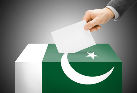 Voting concept - Ballot box painted into Pakistan national flag photo