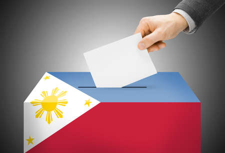 Voting concept - Ballot box painted into Philippines national flag photo